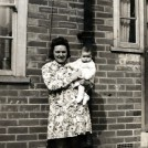 Photo:Ethel Beckwith with daughter Joan at the back door of 86 Tweeddale Road, 1945.