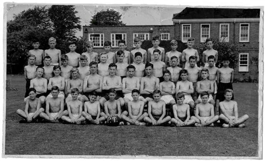 Photo:2nd year gymnastics display team (1950, I was just 13 at the time) Does anyone out there recognise themselves in the picture? I am front row sitting 2nd from the left, next to Len Hawkins..