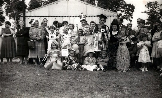 "Photo:Coronation Party in Tweeddale Road. There was a fancy dress competition during the Coronation celebrations. My costume was ""Keep Britain Tidy"" and I won first prize! I'm in the front row, second left with a colander on my head.!"