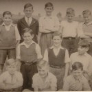 Photo:Glastonbury School pupils 1943(ish) - Sports Team  Taken at Glastonbury School.  Can you identify the missing names?  From left - Top row -  George Cowan, Les Lynch, Peter Reekes, ?, ?, Blandon.  From left - Middle row -  ?, ?, Graham Robinson.  From left - Bottom row -  ?, Brian Ransted, ?.