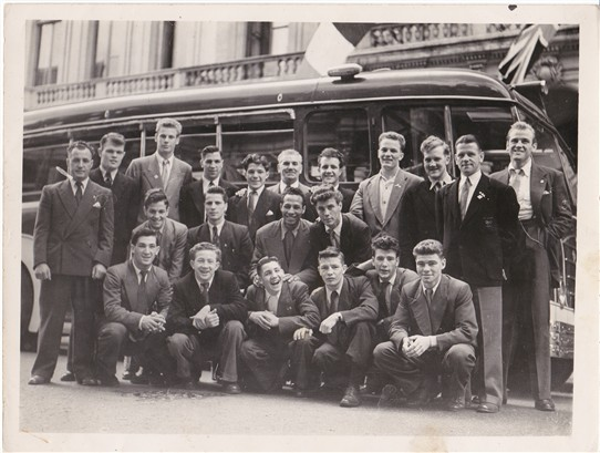 Photo:The 1952 Helsinki Olympic Boxing Squad. Top left- Derik Rowe, Bruce Wells, John Maloney, Bernard Foster, Harry Mallin, Terry Gooding, Henry Cooper, Eddie Hearn, Fred Verlander and Malcolm Cowen. Middle Row- Dai Dower, Tommy Nicholls, Percy Lewis and Fred Reardon. Bottom Row- Ken Phillips, Parry Dando, Ritchie Jenkins, Peter Brander, Peter Waterman and Ron Hinson.