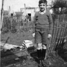 Photo:James Jackson in garden of Peterborough Road (1940) next to the Brown's fence.  Next to broken drain from Andersen shelter.