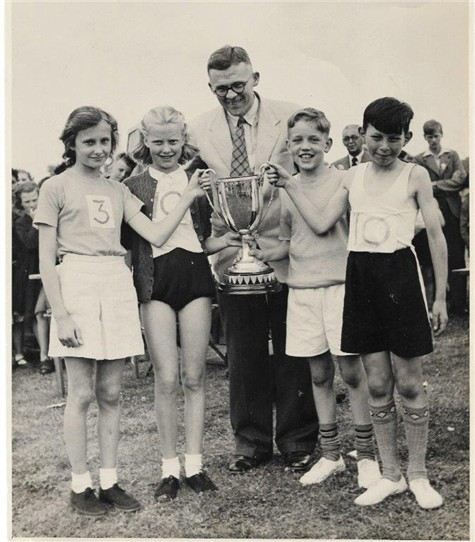 Photo:Headmaster Mr Morris presenting cup at the Inter School Athletics