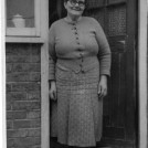 Photo:Mrs. Esther Law  mother of Jack at back door of 220 Wrythe Lane