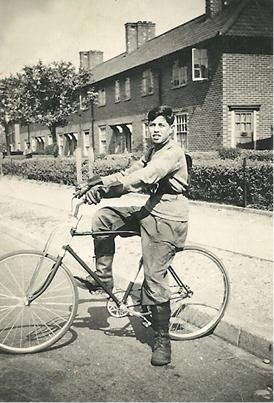 Photo:Norman Miles cycling on the Estate