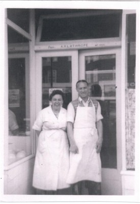 Photo:Arthur and Lil Lathrope in the doorway of their eel and pie shop at the Circle