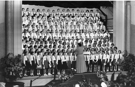 Photo:Isabel Bailey a famous Opera Singer conducting school choirs from the surrounding area, at a hall in Carshalton. Sylvia is in the 3rd row from the top clearly visible on left with pony tail.