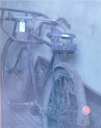 Photo:This old bicycle was spotted through the window of Morden Hall house