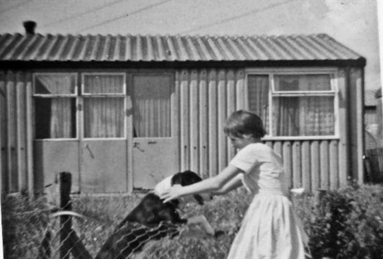 Photo:Playing outside the prefabs